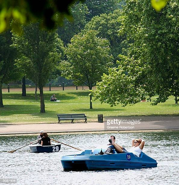A couple relax using a pedalo on the serpetine in Hyde park on May 29 2003 in London England Londoners take advantage of the heatwave hitting the...