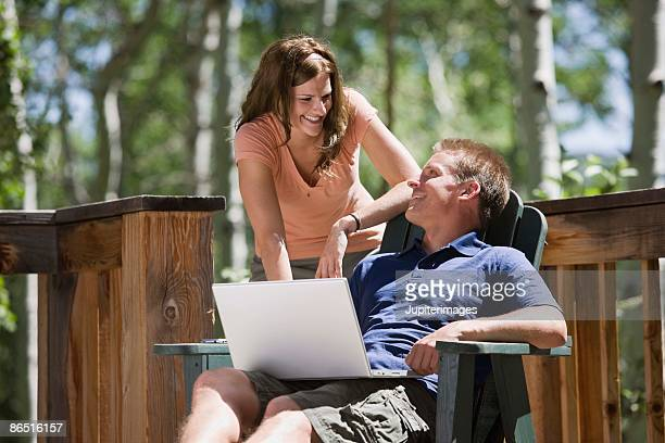 Couple relaxing and using laptop computer