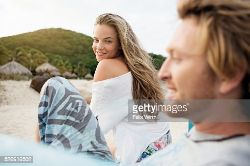 Couple relaxing at beach : Stockfoto