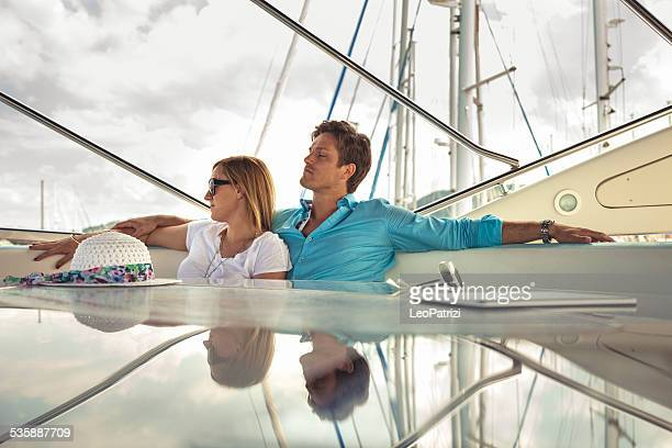Couple relaxing at dusk on their luxury boat