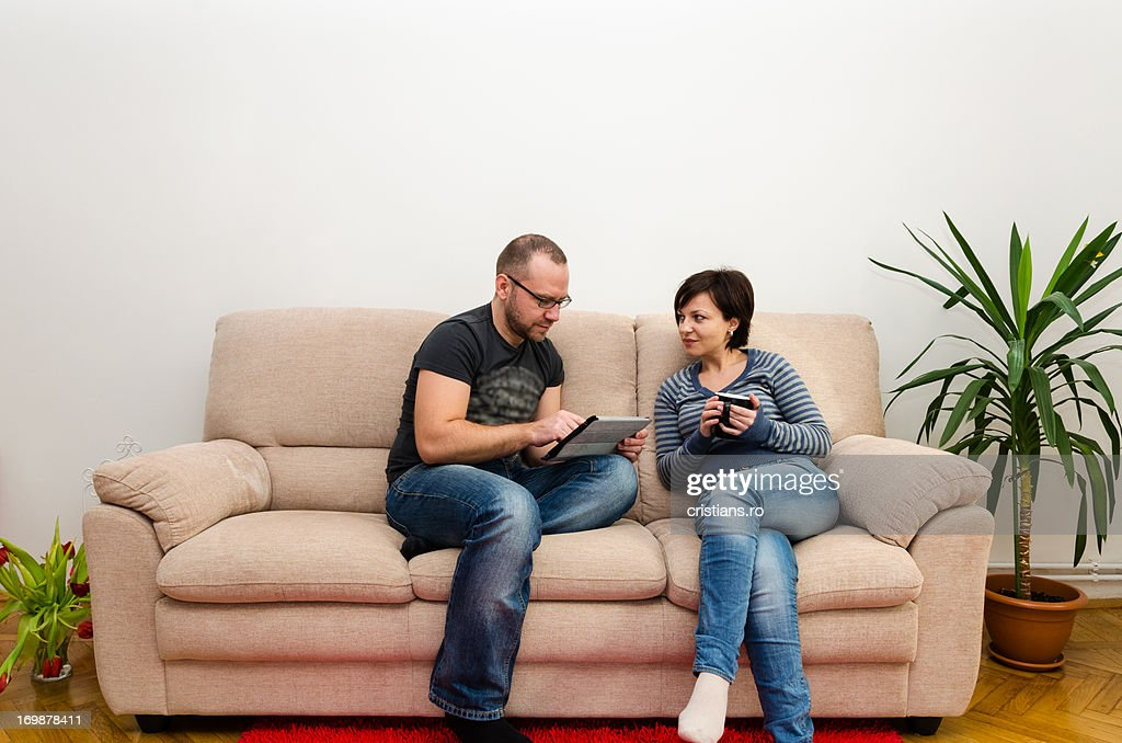 Couple relaxing at home : Stock Photo