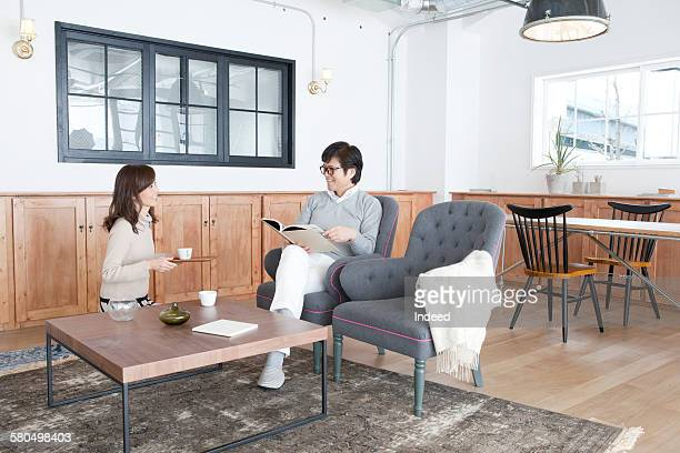Couple relaxing at living room