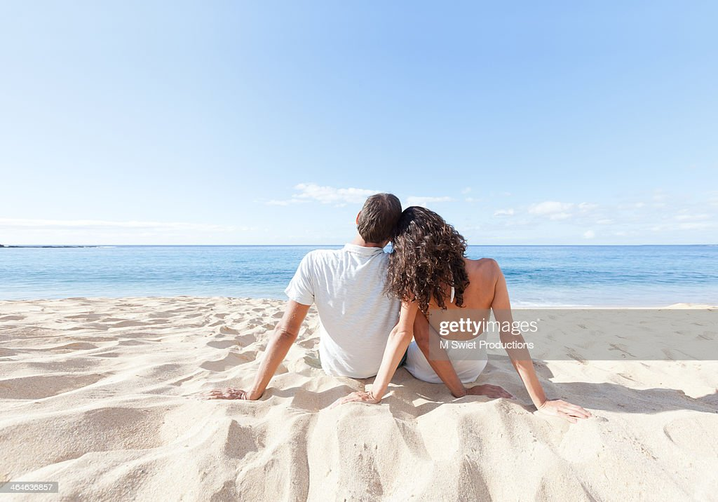 Couple relaxing beach : Stock Photo