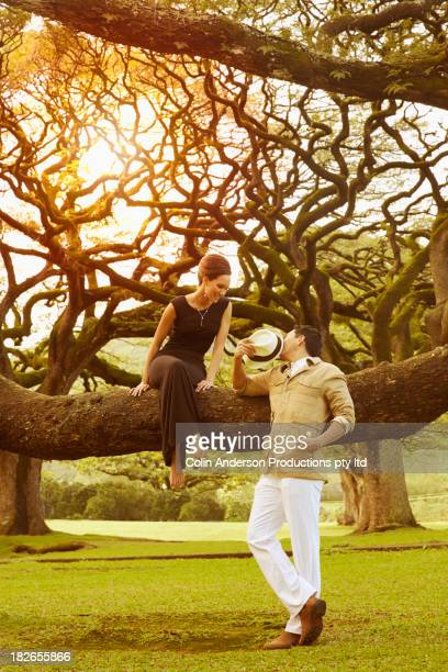 Couple relaxing by banyan tree