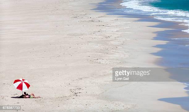 Couple relaxing, Claytons Beach, Mindarie, Western Australia, Australia, Pacific