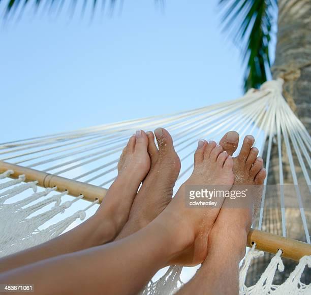 couple relaxing in a hammock on beach