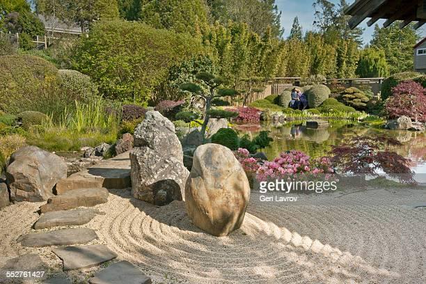 Couple relaxing in a zen meditation garden