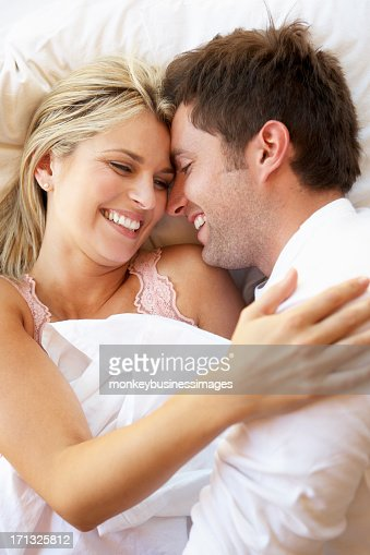 Couple Relaxing In Bed : Stock Photo