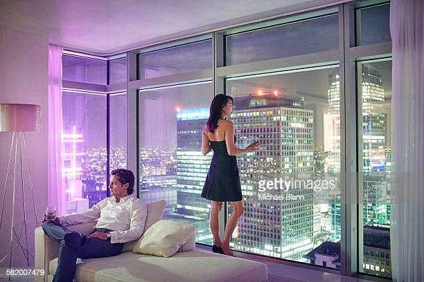 couple relaxing in city apartment at night
