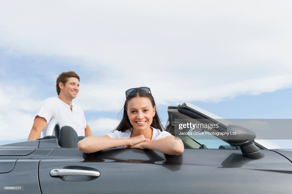 Couple relaxing in convertible
