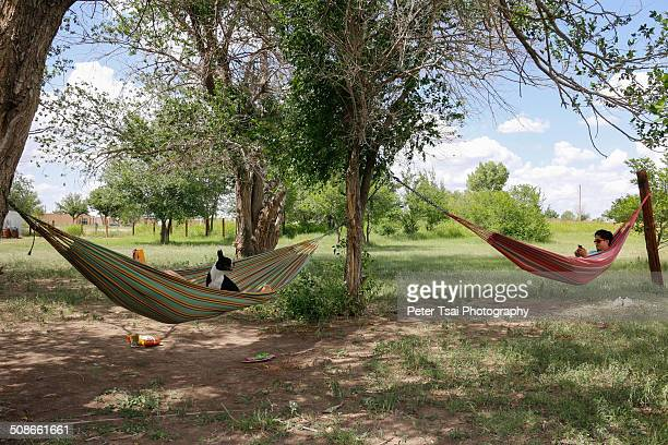 A couple relaxing in hammocks at the El Cosmico campsite in Marfa Texas