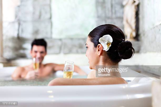 Couple relaxing in jacuzzi at health spa