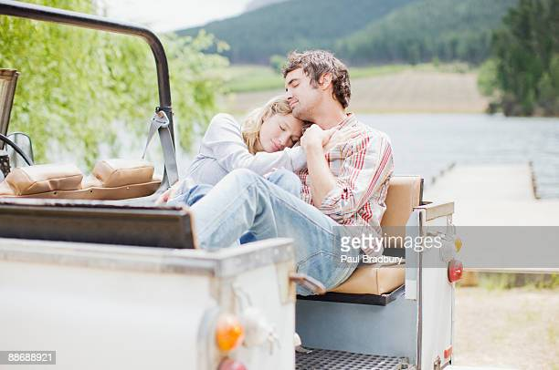 Couple relaxing in jeep