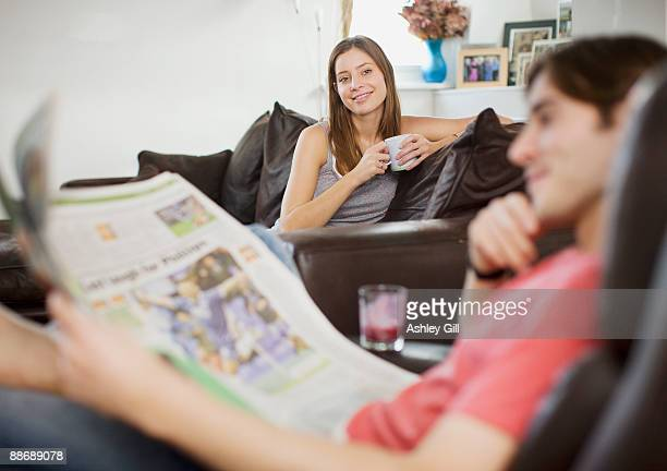 Couple relaxing in living room together