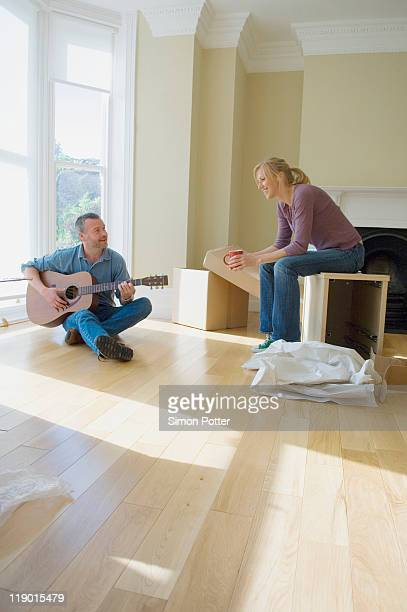 Couple relaxing in new home