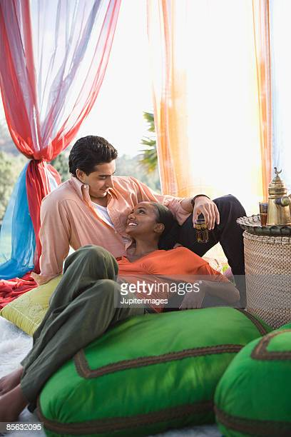 Couple relaxing in outdoor room