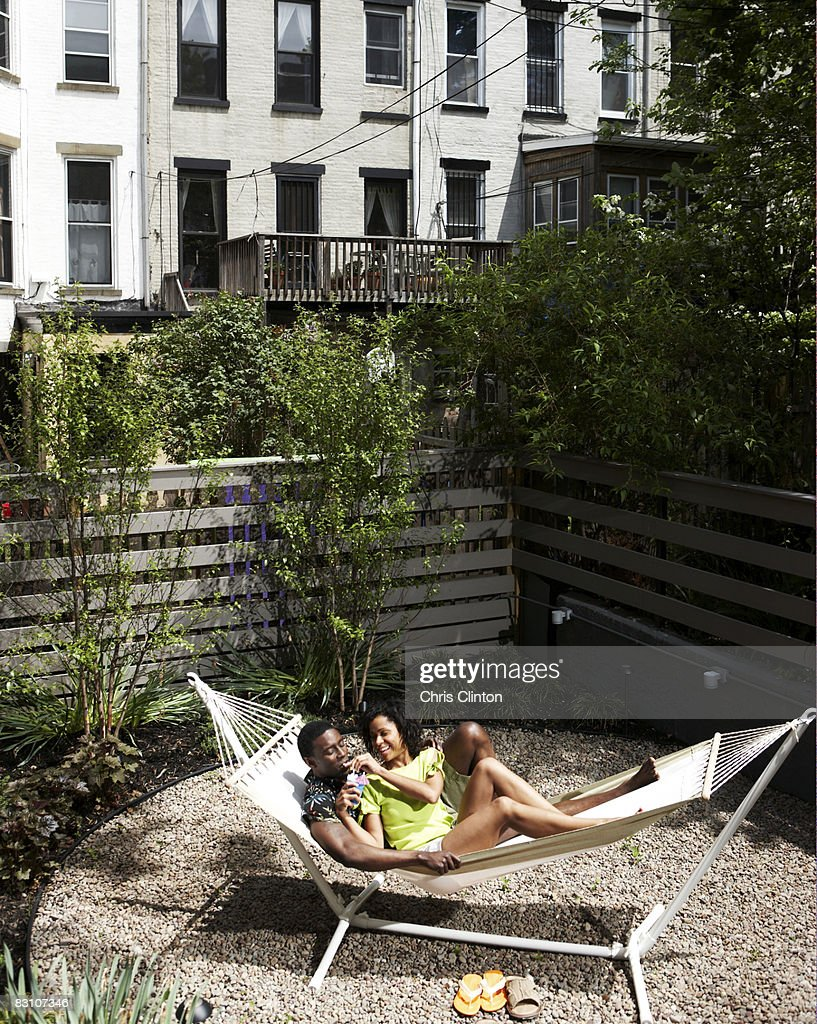 couple relaxing in urban backyard hammock stock photo getty images