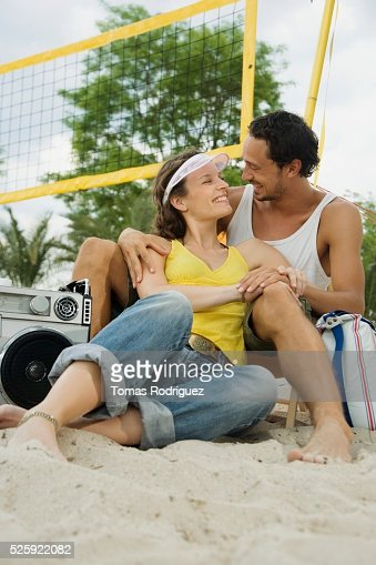 Couple Relaxing on a Beach : Stock Photo