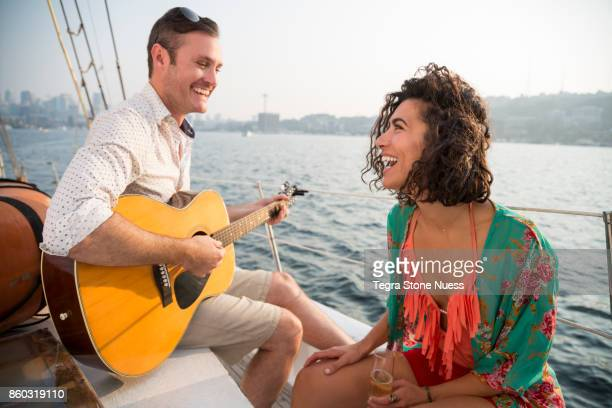 Couple Relaxing on a Sailboat