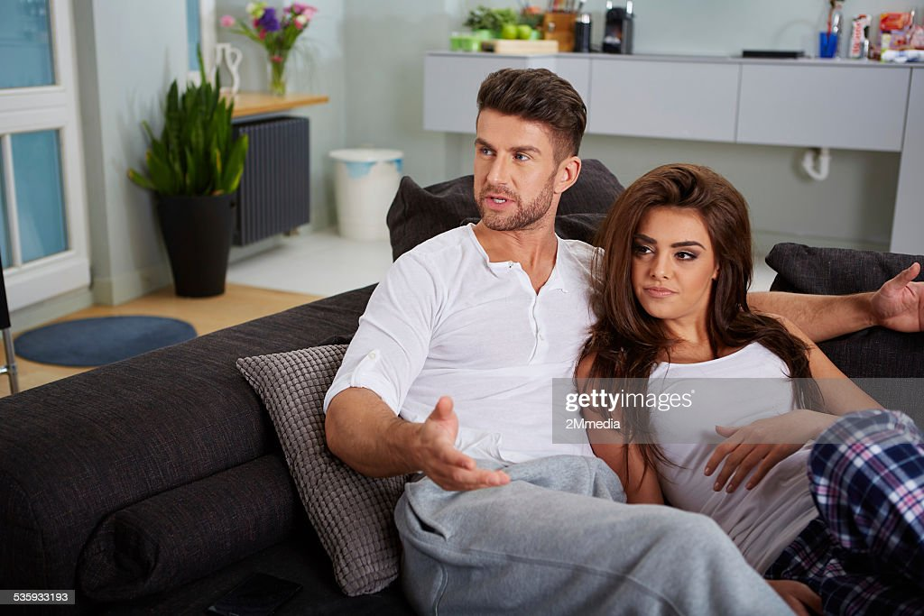 Couple relaxing on a sofa : Stock Photo
