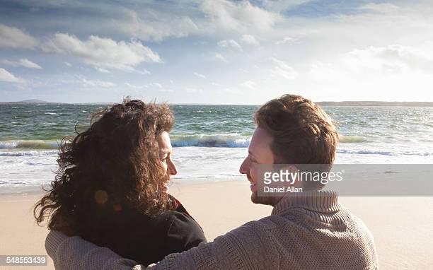 Couple relaxing on beach, Connemara, Ireland