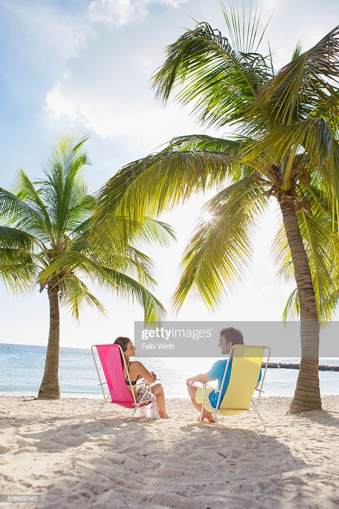 Couple relaxing on beach lounger : Stock Photo