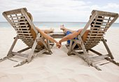 Couple relaxing on beach