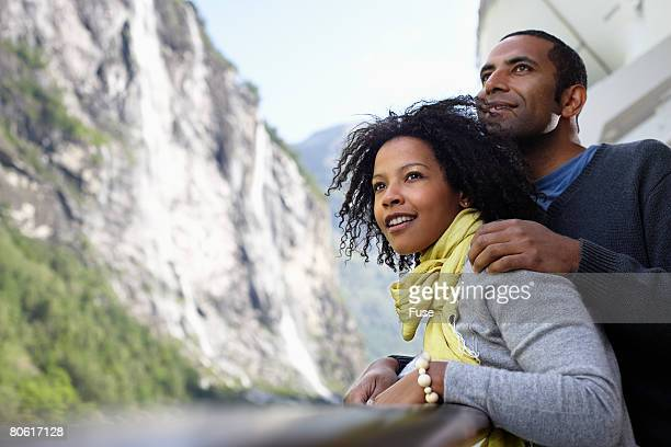 Couple Relaxing on Cruise Ship Looking at the View