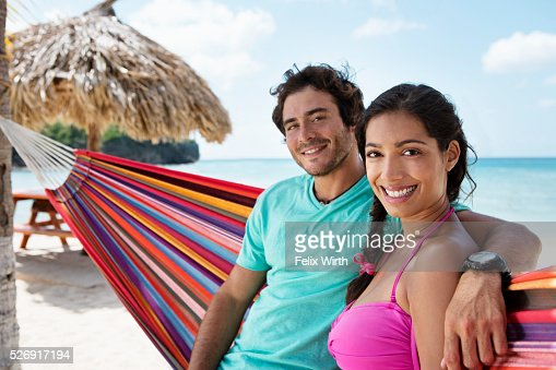 Couple relaxing on hammock on beach : Stock-Foto