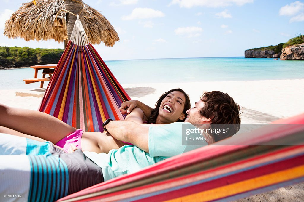Couple relaxing on hammock on beach : Stock Photo