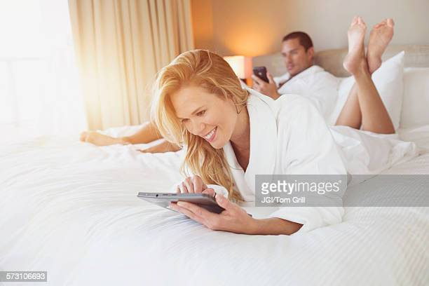 Couple relaxing on hotel bed