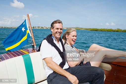 Couple relaxing on motorboat : ストックフォト