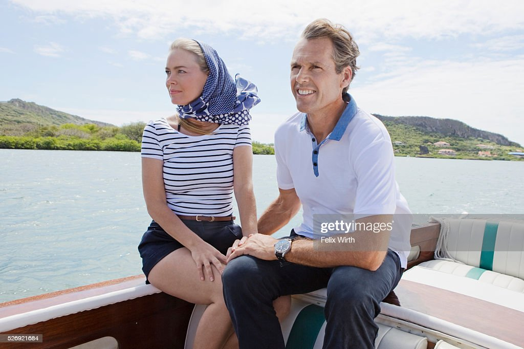 Couple relaxing on motorboat : Stock Photo
