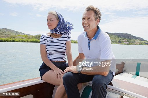 Couple relaxing on motorboat : Stock-Foto