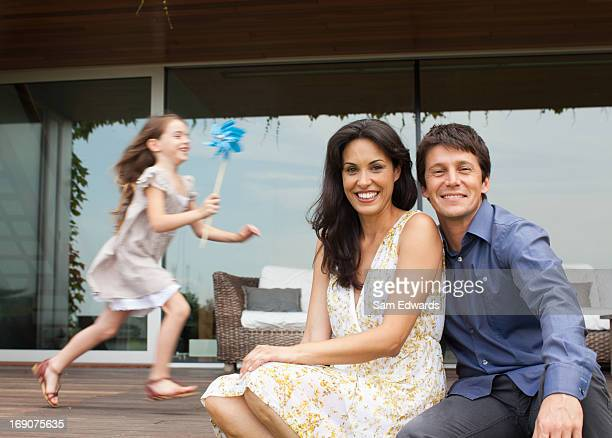 Couple relaxing on patio together