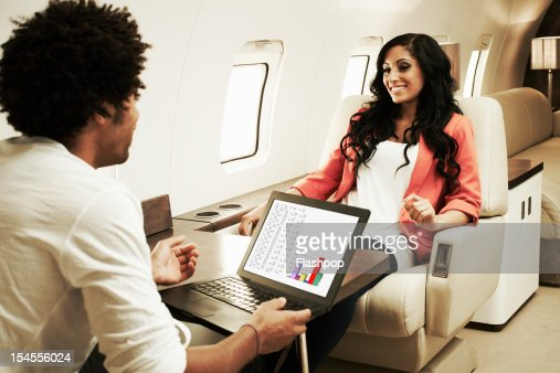 Couple Relaxing On Private Jet Stock Photo  Getty Images