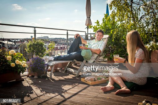 Couple Relaxing On Roof Terrace, Munich, Bavaria, Germany, Europe