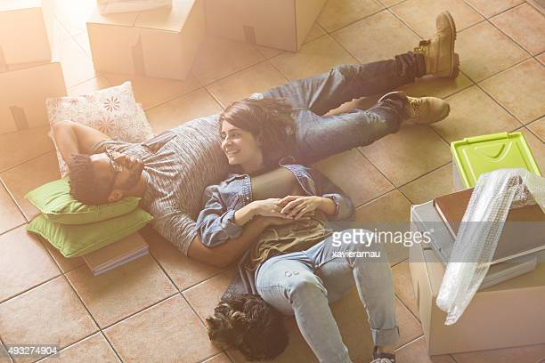 Couple relaxing on the floor at their new home