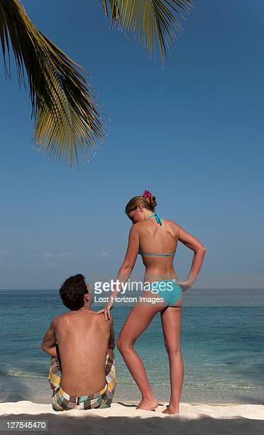 Couple relaxing on tropical beach