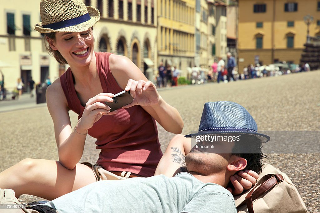 Couple relaxing, Palazzo Pitti, Florence, Tuscany, Italy