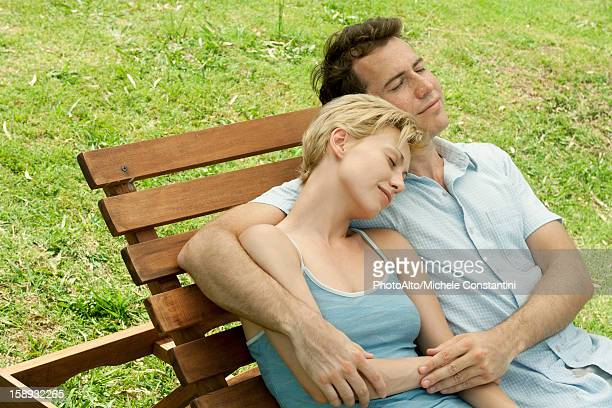 Couple relaxing together on lounge chair