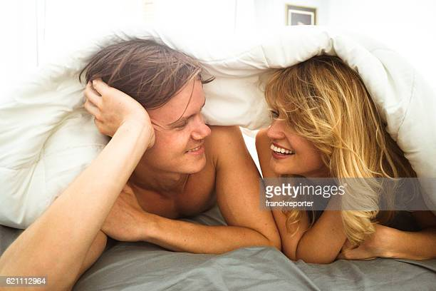 couple relaxing under the sheet