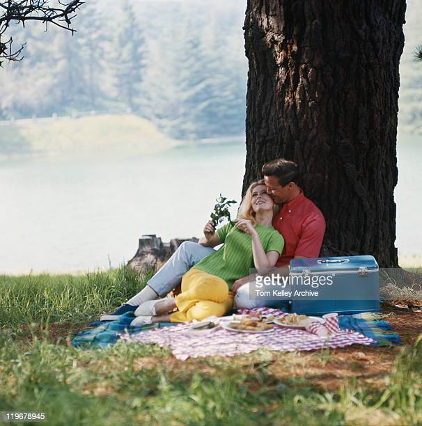Couple relaxing under tree