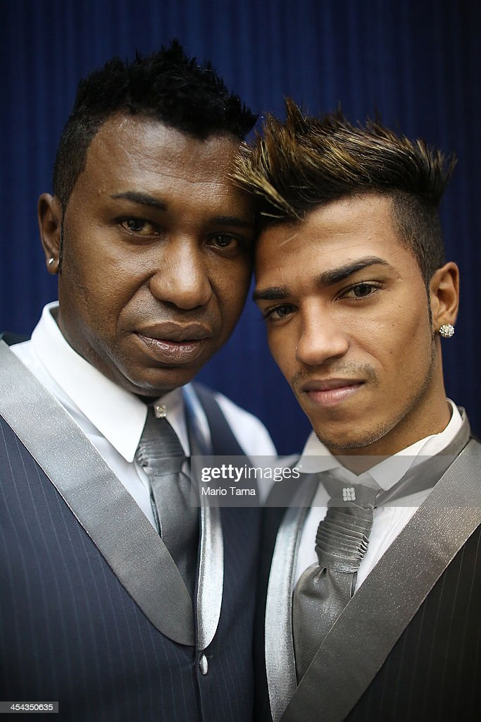 Couple Renato (L) and Ronald, together nine months, pose before marrying at what was billed as the world's largest communal gay wedding on December 8, 2013 in Rio de Janeiro, Brazil. 130 couples were married at the event which was held at the Court of Justice in downtown Rio. In May, Brazil became the third country in Latin America to effectively approve same-sex marriage via a court ruling, but a final law has yet to be passed.