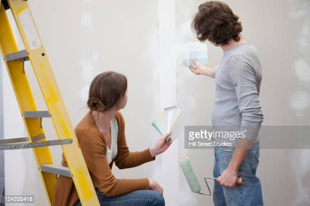 Couple renovating room together