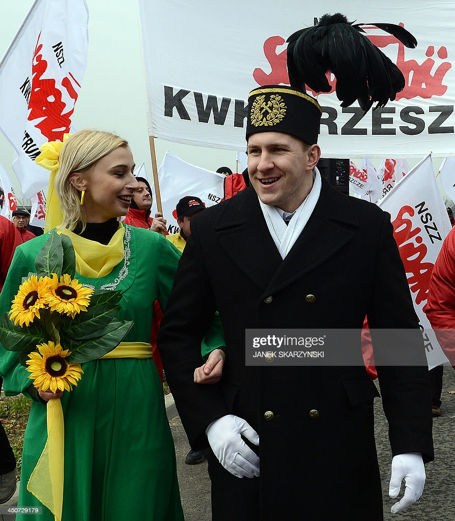 A couple representing 'Ecology' (L) and 'Coal' (R) perform a wedding ceremony to show that both can coexist during a Solidarity trade union happening in front of the National Stadium hosting the United Nations Climate Change Conference COP 19 in Warsaw on November 20, 2013. Rich and poor countries faced off at climate finance talks in Warsaw on Wednesday as UN chief Ban Ki-moon called for 'much bolder' spending to stave off an existential peril. AFP PHOTO / JANEK SKARZYNSKI