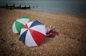 A couple rest under umbrellas on the beach on August 3 2011 in Whitstable England Parts of southern England are experiencing high summer temperatures