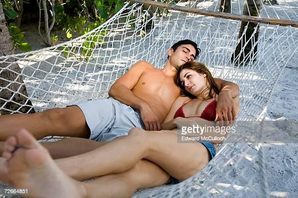 Couple resting in hammock