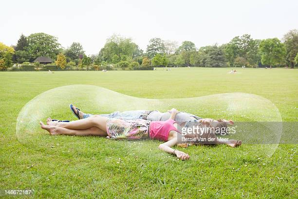 couple resting, surrounded by long bubble