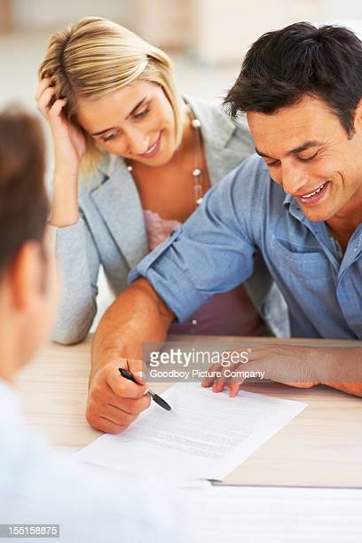 Couple reviewing contract